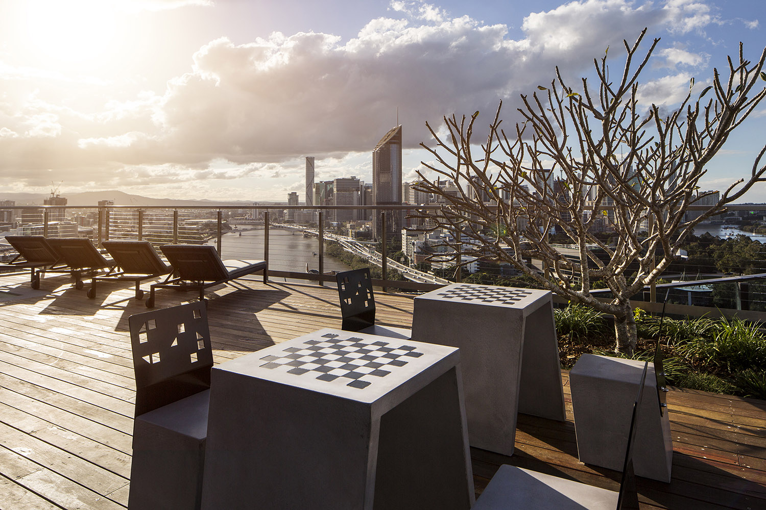 Boksi Concrete Stools with Concrete Chess Tables (Table design and photo by Aria Property Design)