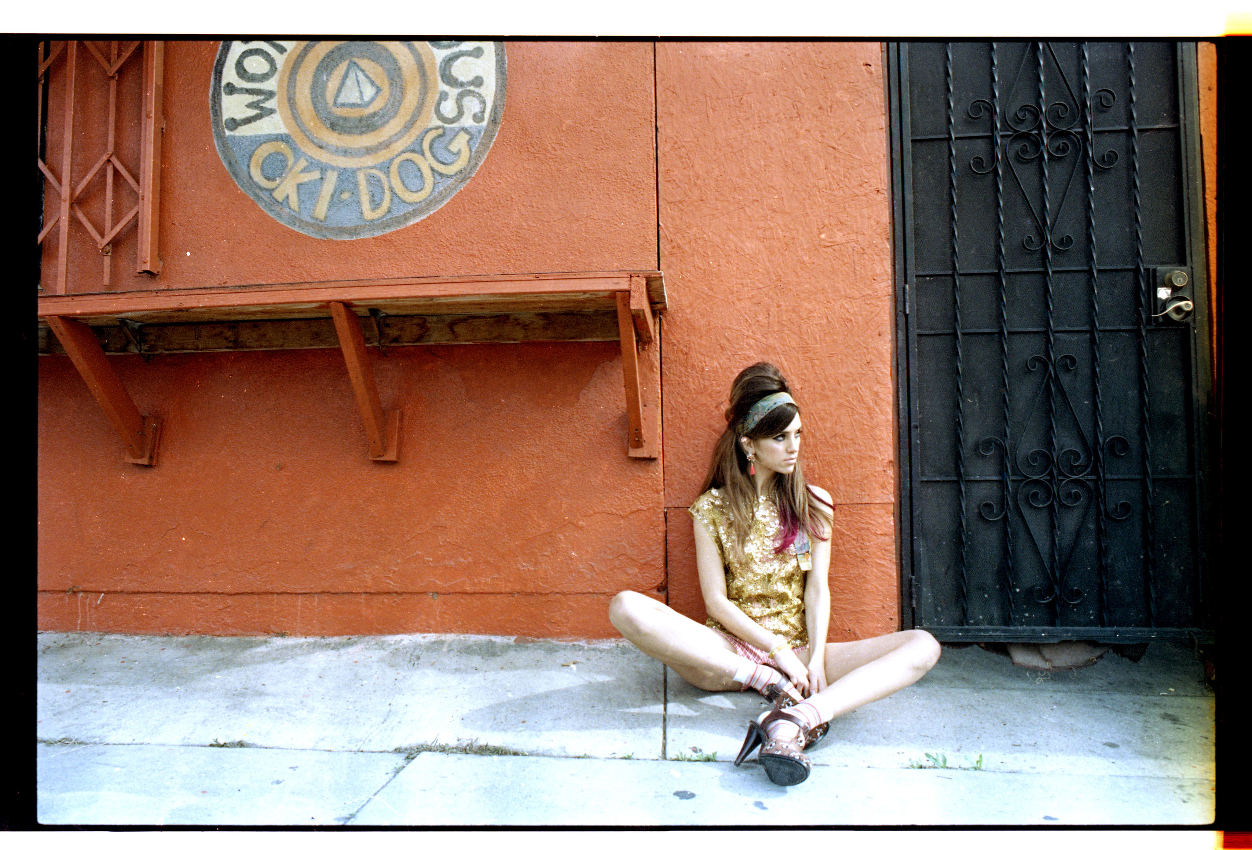 Top, scarf, andshorts,Warner Archives. Shoes,Opening Ceremony. Earrings, H&M.