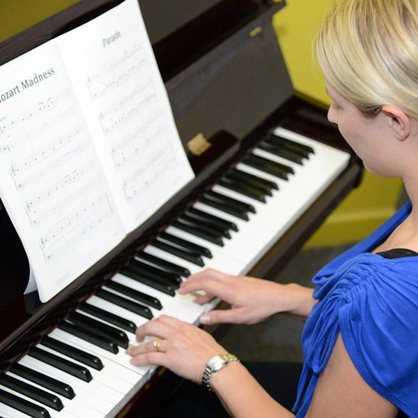 Adult-at-piano-SQ.jpg