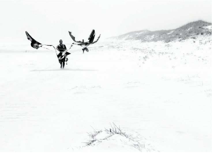 Local kiters Josh Walton and Jonn Myers walking their kites down wind. (Photo by Scott Walton).