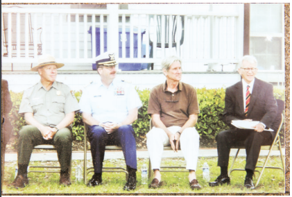 Timothy Stone, Capt. Michael F. White, Hal Coste and Mayor Joe Riley at a ceremony honoring James Coste in 2013.