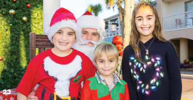 The Schroder family visits with Santa at the IOP Christmas Carnival