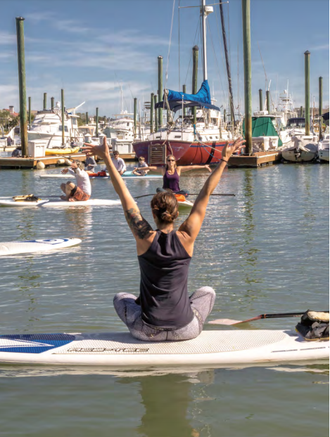 Jaime Muehl leads a SUP Yoga class at the IOP Marina