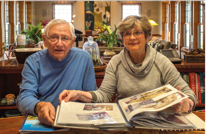Jim and Anne Anderson looking at photos of building their home on Dewees.