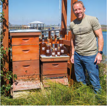 Eric Dodson shows off his bees' bounty.
