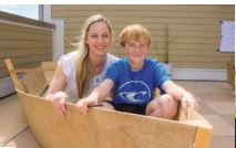 Anna McRae helps her son Leo build a boat at SIES