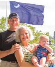 Michael and Mary Regner with third-generation Sullivan's Islander, Fritz Sottile Linton, celebrate Carolina Day