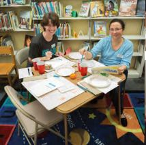 Delores Schweitzer and Marie Sollitt try their hands at watercolors at Poe Library