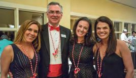 President and CEO of East Cooper Meals on Wheels, George Roberts, with Tracy Migliara, Jenny Ladd and Christy Winer at the organization's fundraiser