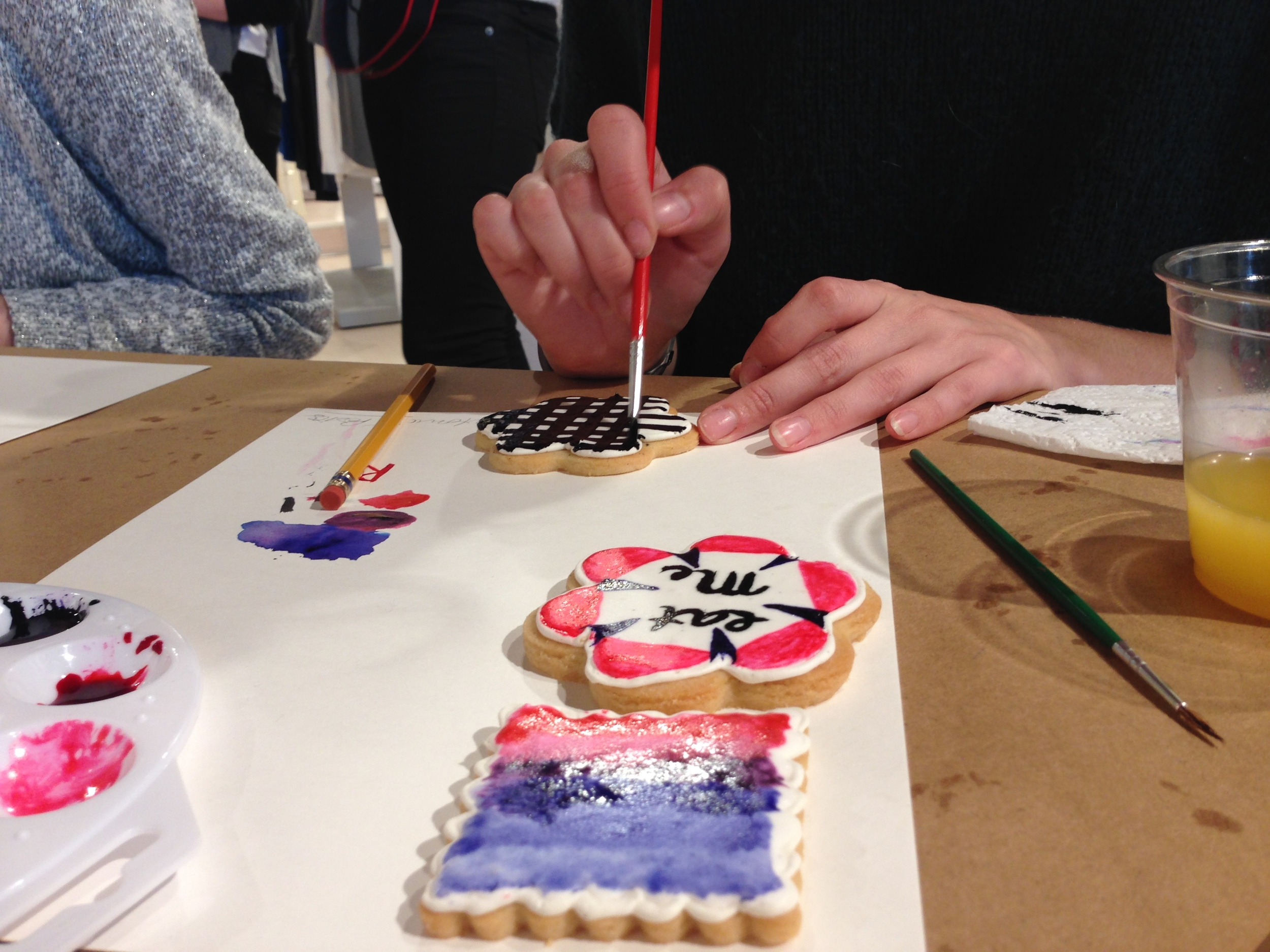 These are the hands and cookies of my class buddy Abigail. She is a talented artist (not just limited to cookies)and happens to live a few blocks from the house I grew up in! Turns out, she had her own booth at Art Goggle this fall and I visited her booth!