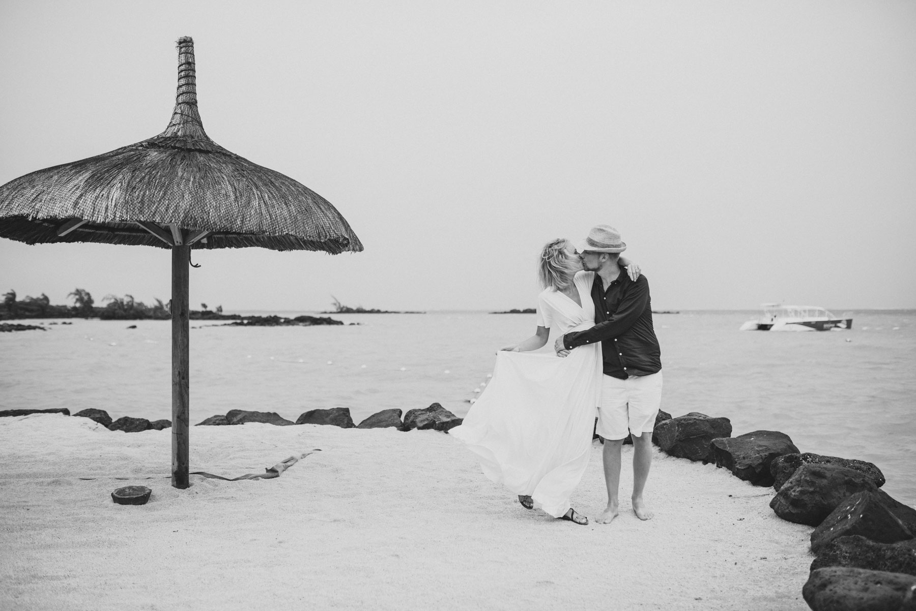 Copy of Sita Kelly | Mauritius Honeymoon Photographer | Couple kissing in wind in front of the sea