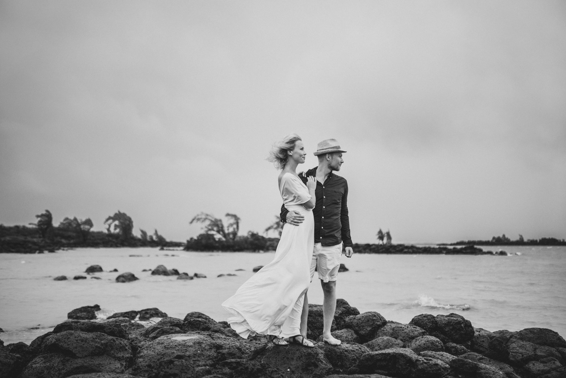 Copy of Sita Kelly | Mauritius Honeymoon Photographer | Couple kissing standing on rocks looking at sea