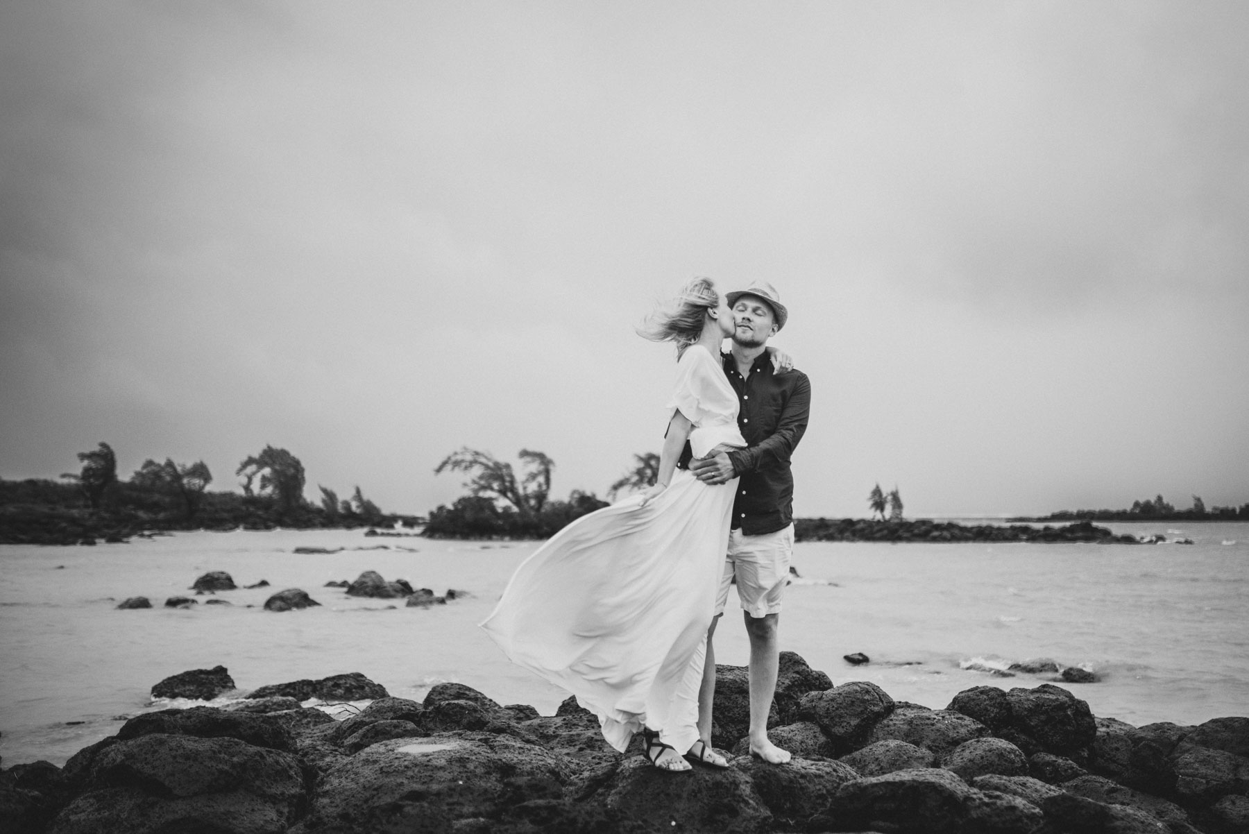 Copy of Sita Kelly | Mauritius Honeymoon Photographer | Couple standing on rocks | Couple kissing in wind in front of the sea