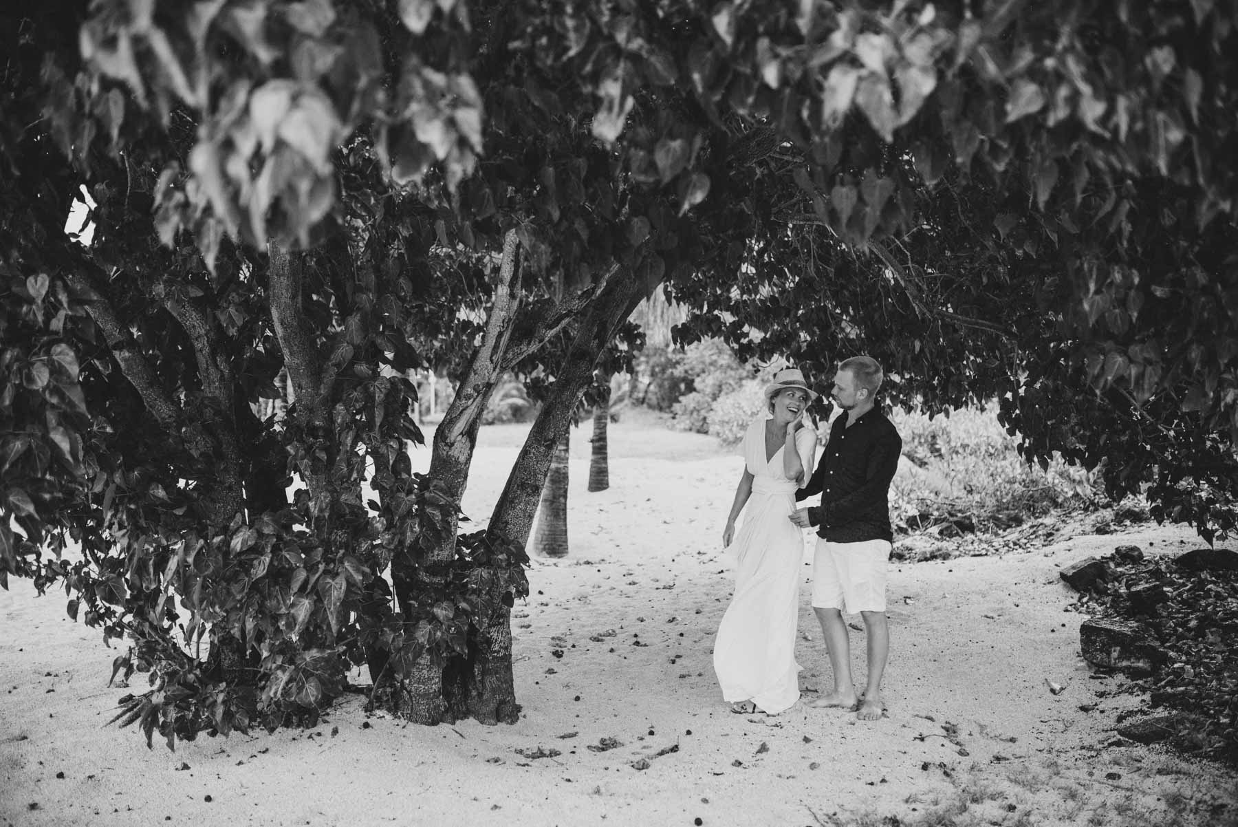 Copy of Sita Kelly | Mauritius Honeymoon Photographer | woman in white dress with man in hat under a tree