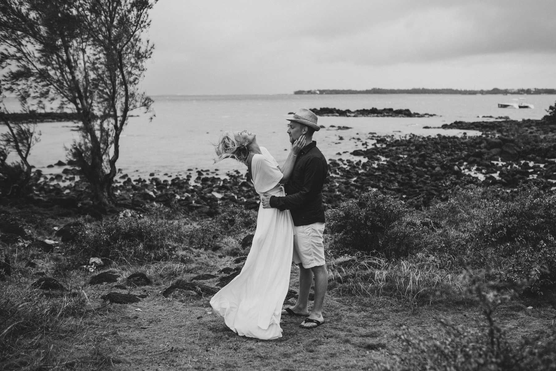 Copy of Sita Kelly | Mauritius Honeymoon Photographer | Couple embracing, woman laughing