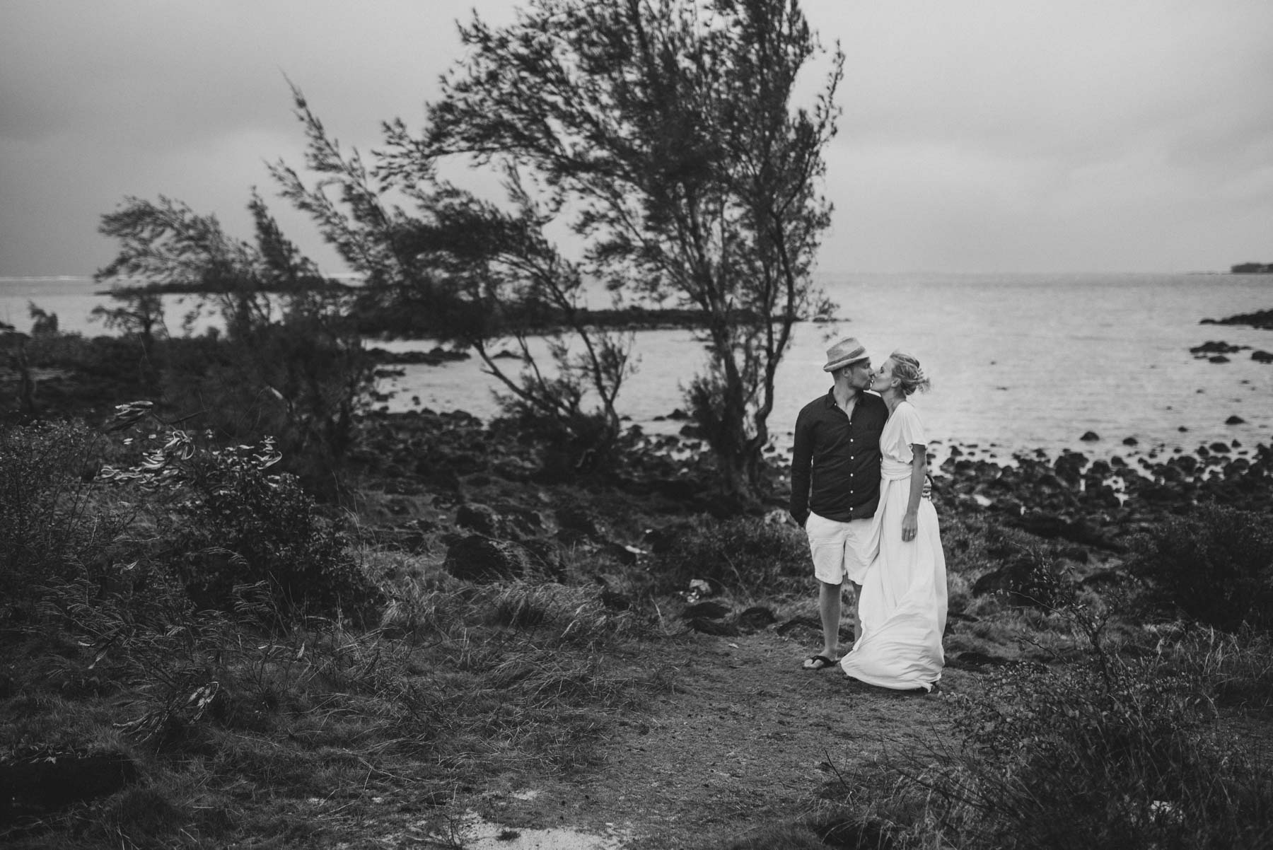 Copy of Sita Kelly | Mauritius Honeymoon Photographer | Couple kissing on cliff