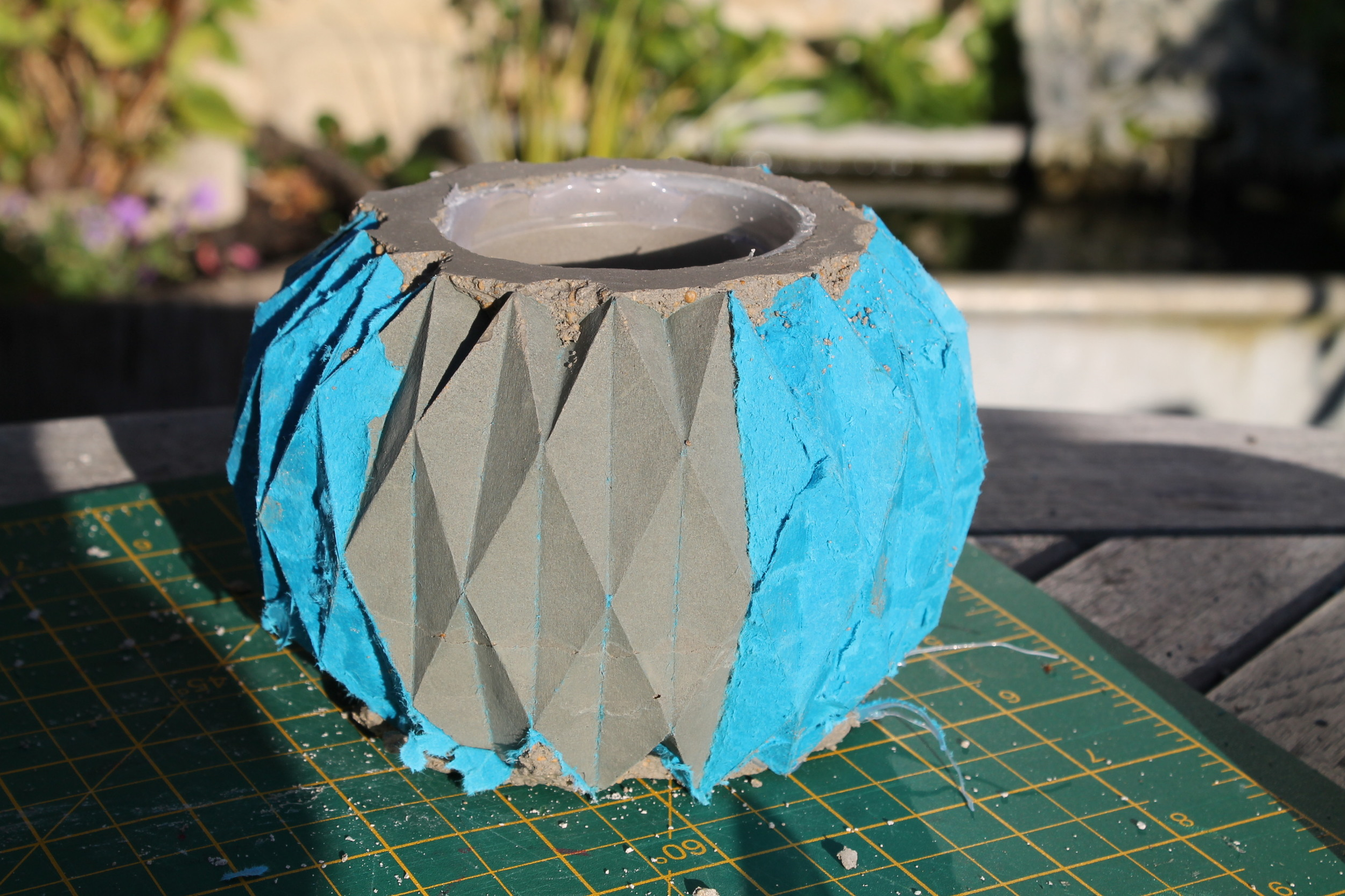 ⬆  - The concrete was mixed with Plaster of Paris. This sets the mixture fast   but allows the pot to be chiselled into its final form before it sets completely after a day.