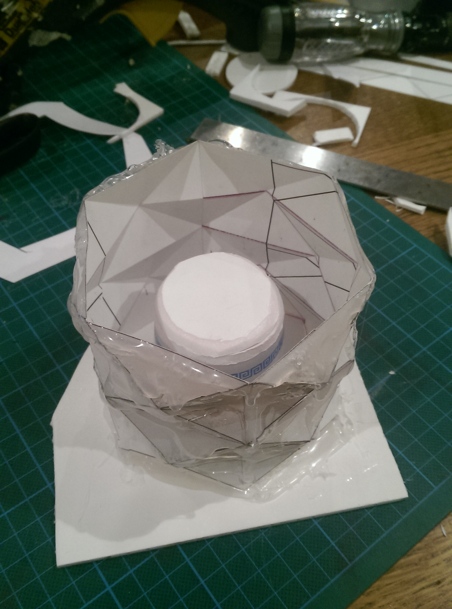 ⬆  - Thick card was folded into the desired pattern and reinforced with hot glue. A plastic pot with draft creates the hollow in the pot.