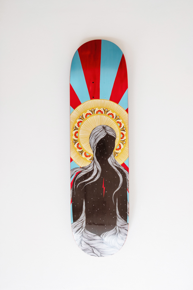 Artwork on a skateboard deck designed by local Asheville artist Hannah Dansie, available for commercial work.