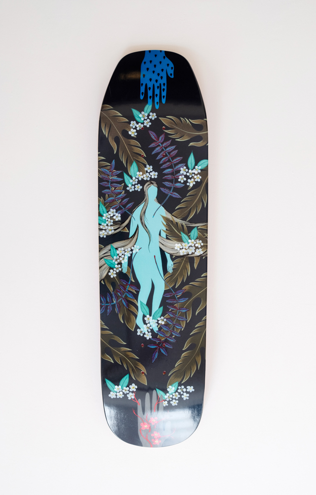 Commercial Artwork by Hannah Dansie, an Asheville local and artist shown here on a skateboard deck.