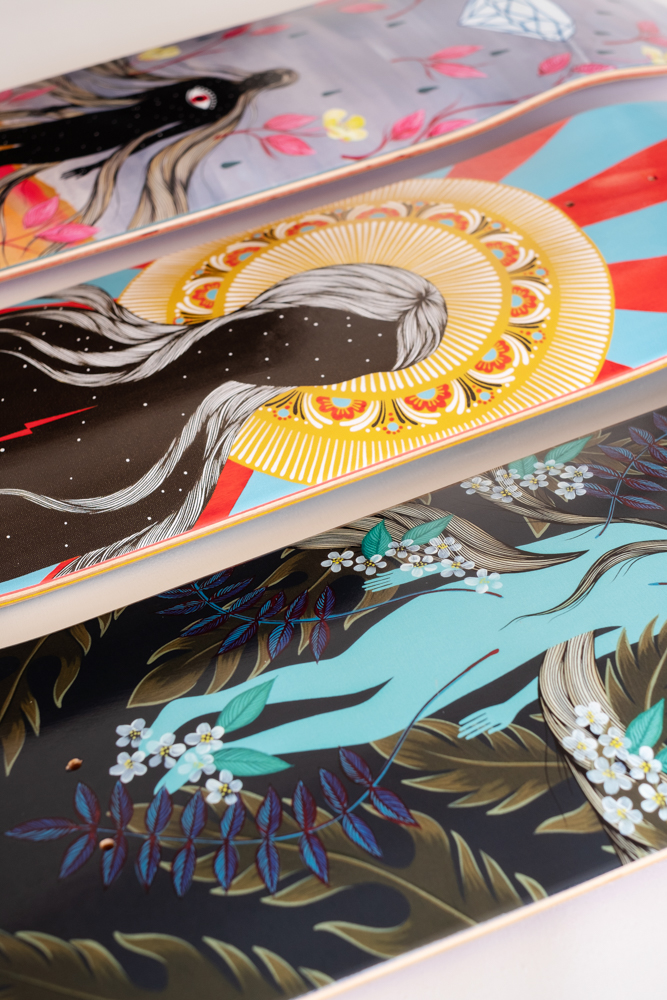 Close up of three skateboard decks showing artwork designed by local Asheville, NC artist Hannah Dansie available for commercial artwork projects.