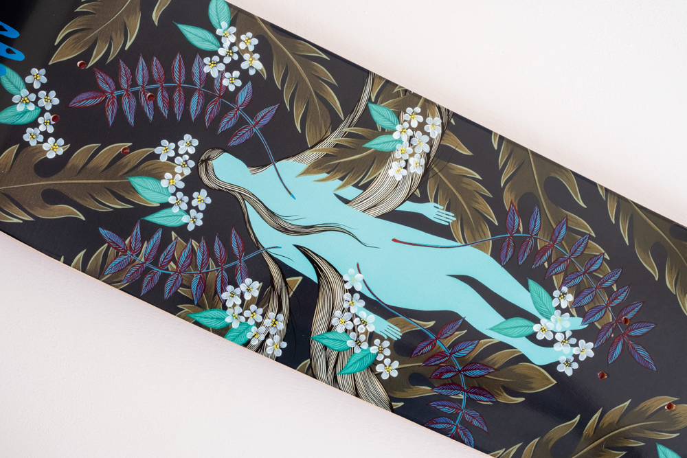 Close up of artwork on a skateboard deck by Hannah Dansie, local Asheville artist.