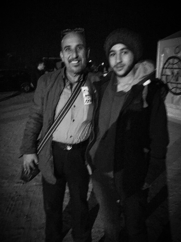 Adnan and his father, Maan smile for a picture