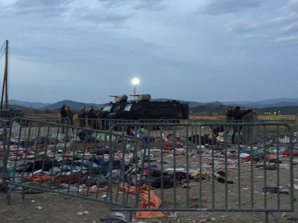 Macedonian armored vehicles guard the border as night falls in Idomeni