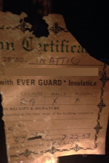 I found this tattered certificate hanging from one of the rafters. It says in 1983 the attic was insulated to R-19, but the walls and floors are uninsulated.