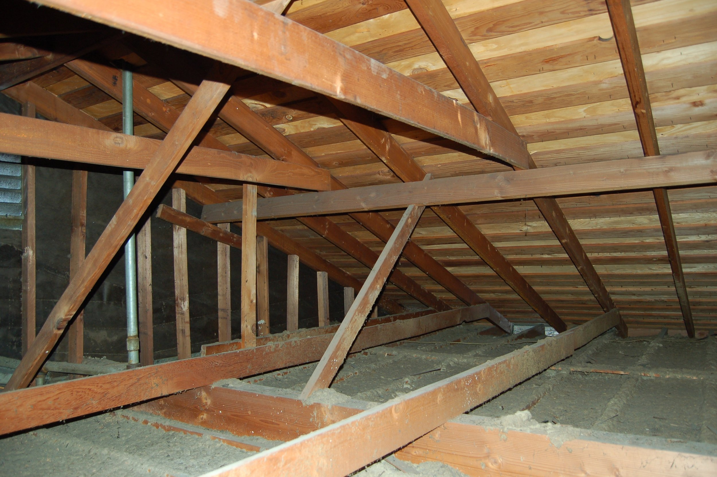 View of the existing attic over the common area, looking northeast. The 6x13 beam runs across the bottom of the photo.