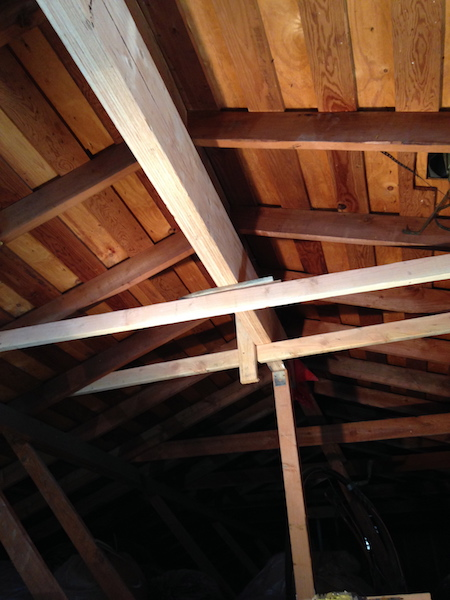 We installed temporary supports to hold the ridge beam in place while we prepared the permanent supports.