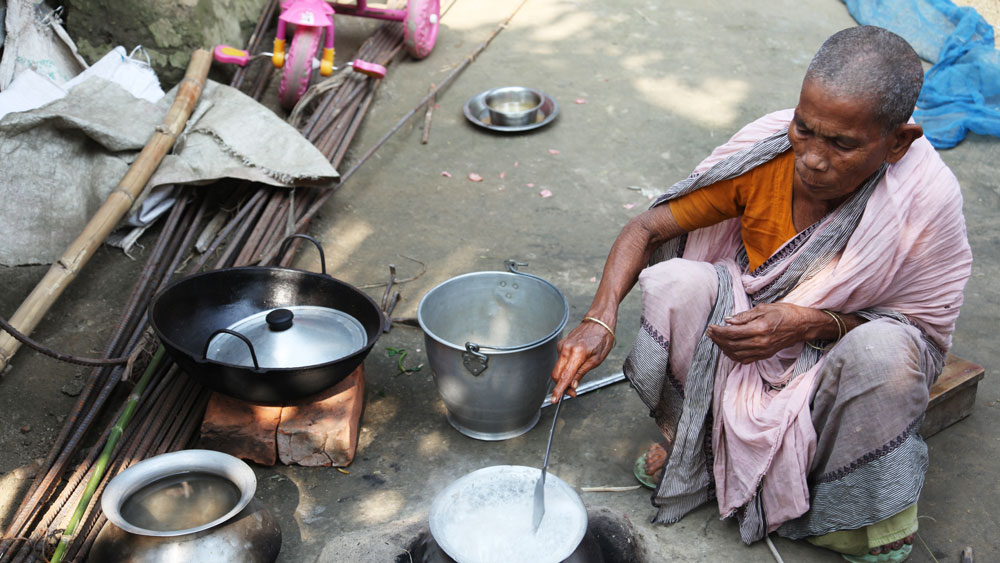 Woman cooking on an earthen stove
