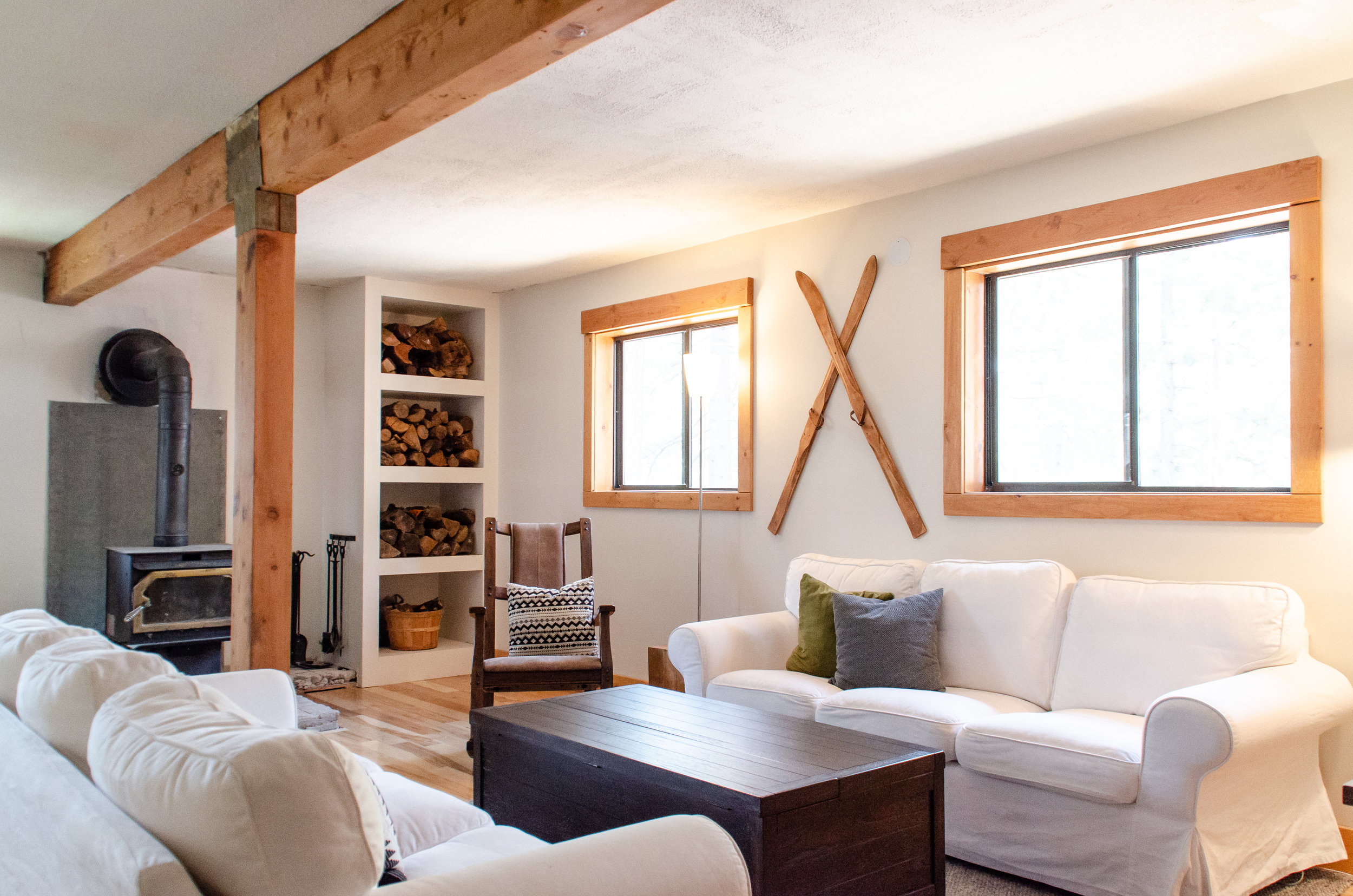 Living room decorated with vintage skis and trunk coffee table