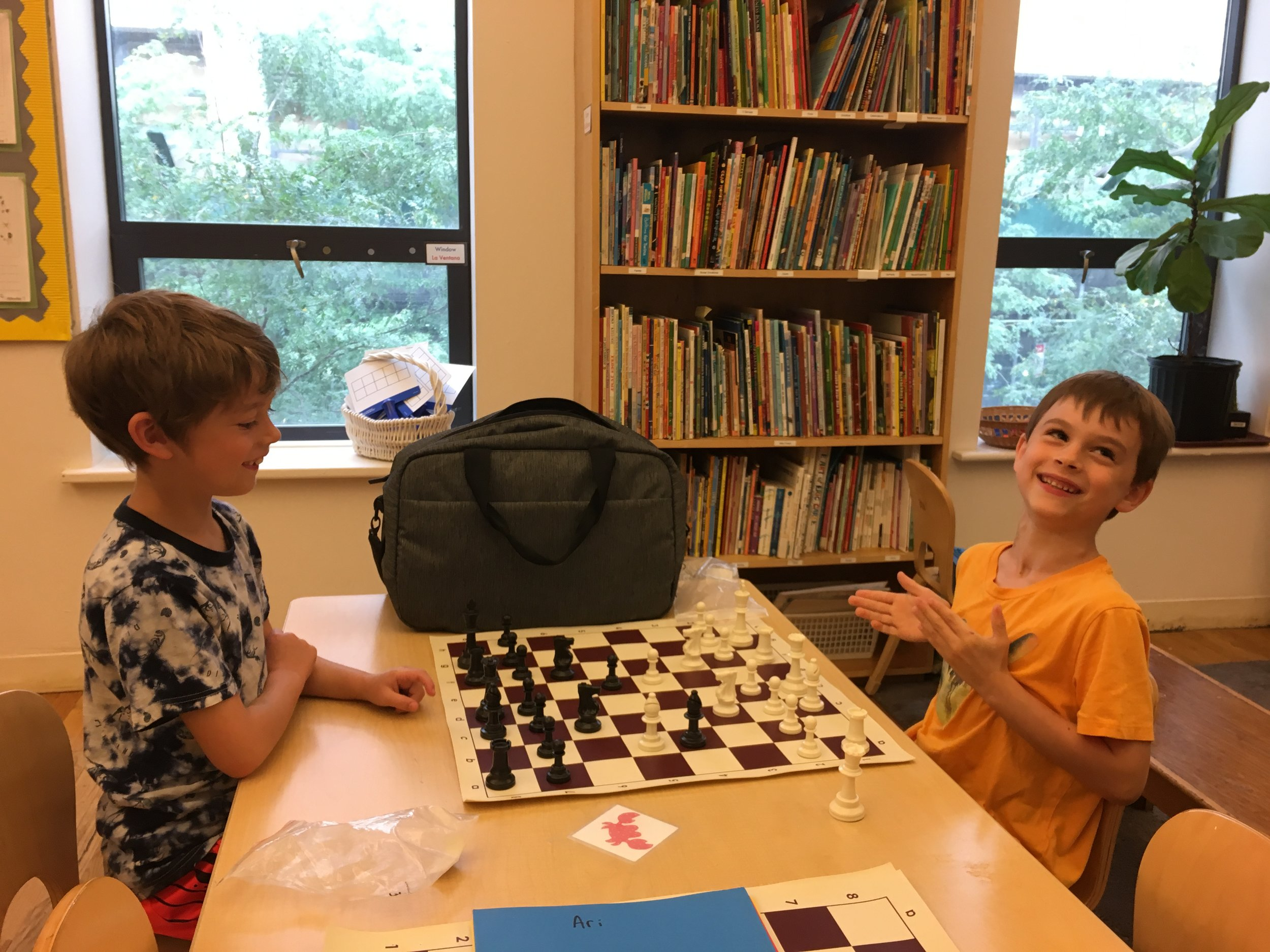 Students practice their skills during a session of Chess.