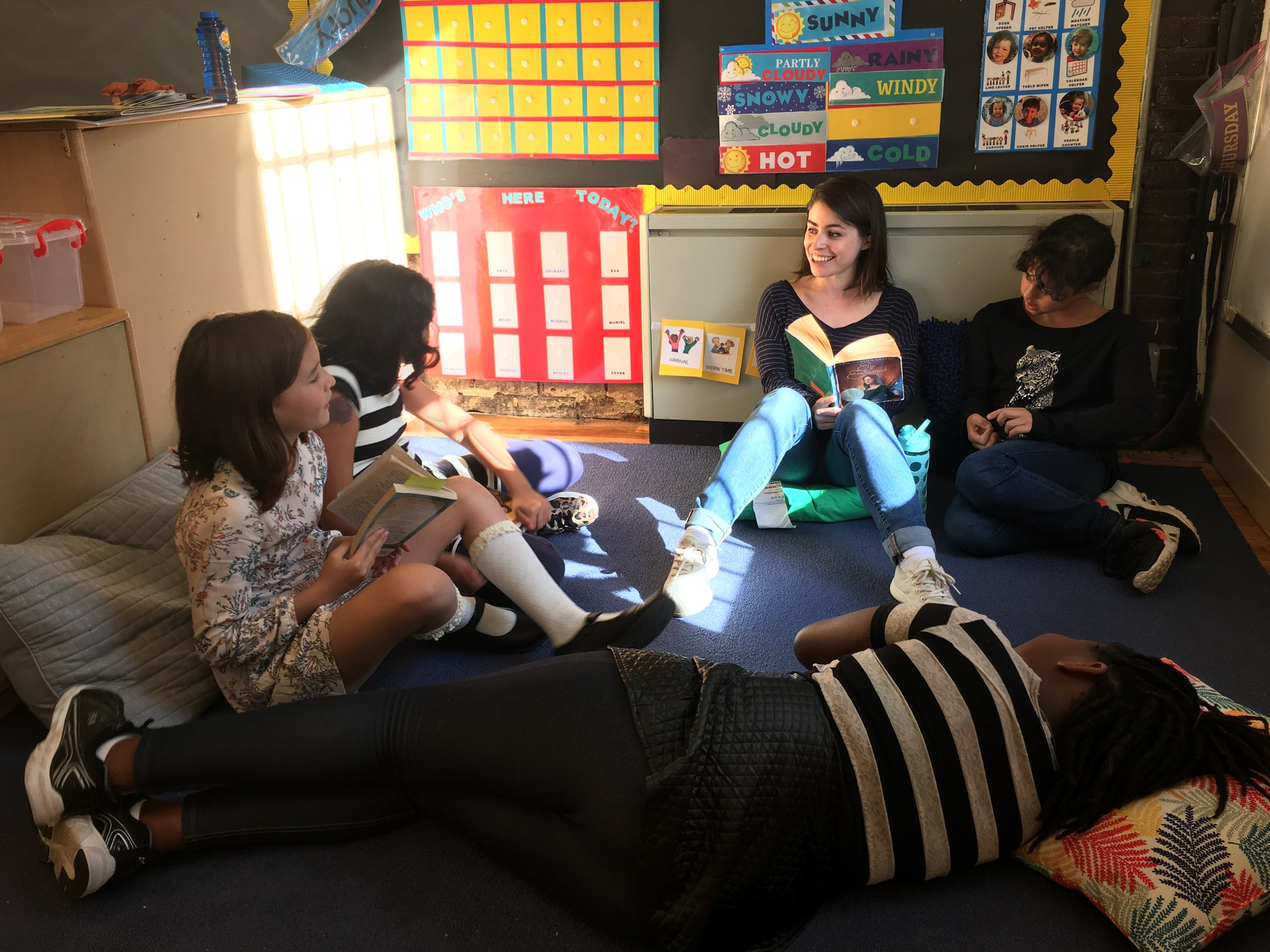 Students discuss their reading at Book Club with Kelly