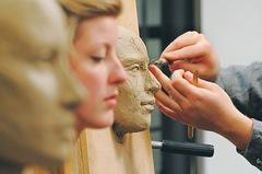 Georgia Rhodes | Jackson Citizen Patriot  |  Kathryn Snyder sits still while sculptor Brandon Irish works on a clay sculpture.