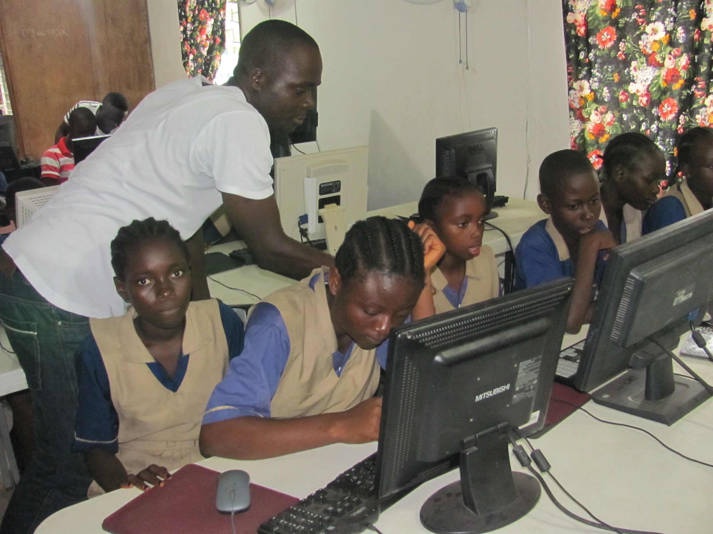 James Toe conducting computer training class for the young students at the Heart of Grace School in Monrovia