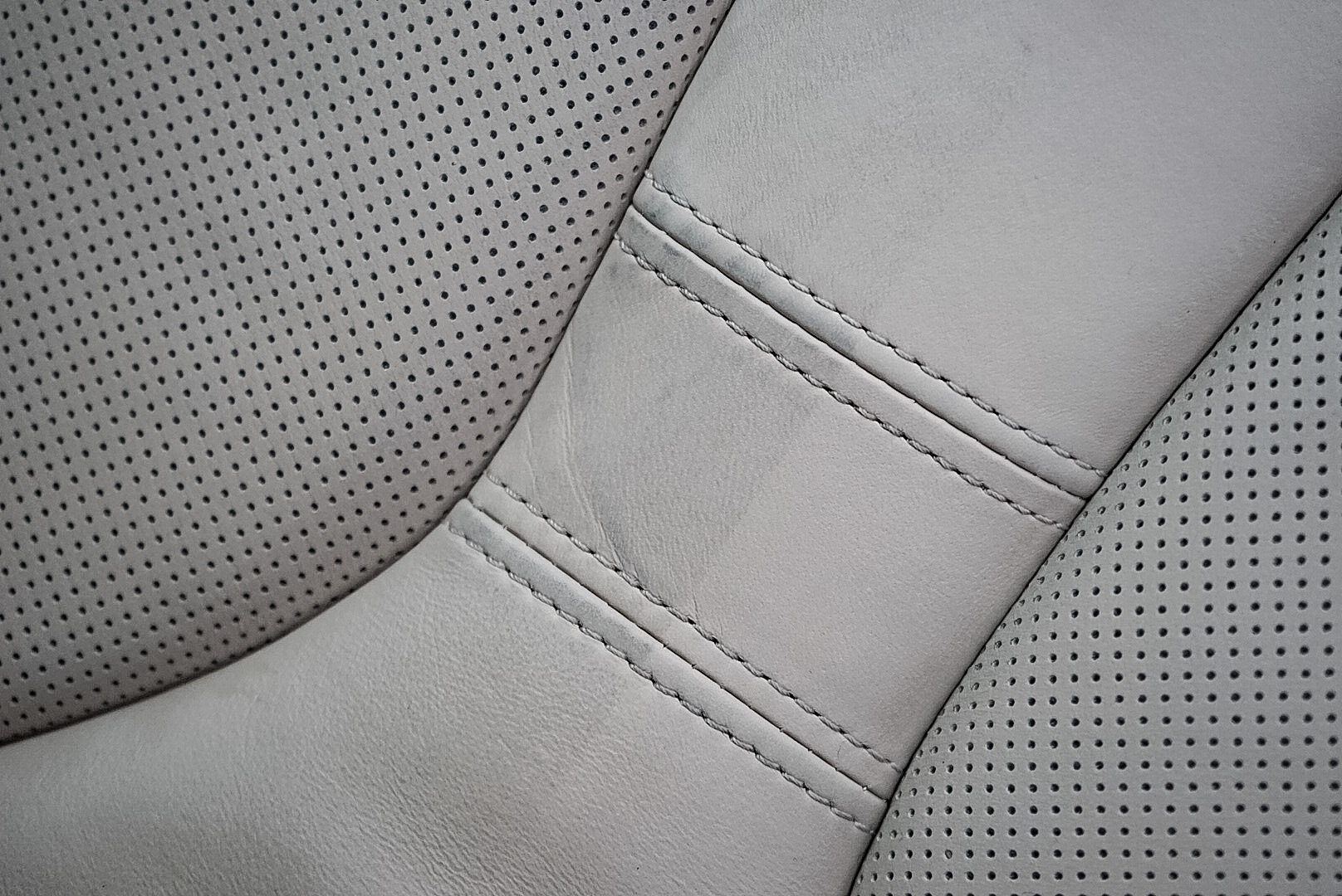 50/50 Shot of the drivers seat from a 1 Week old BMW. The left shows the dye transfer and staining after one weeks use. This car has received dealer protection and allegedly has leather guard applied. The right is after a very light clean using Leather cleaner showing the natural colour of the leather and that the dealership applied protection (Gaurd X) Is not offering protection against die transfer and soiling. Proof that dealership protection is not offering as marketed.