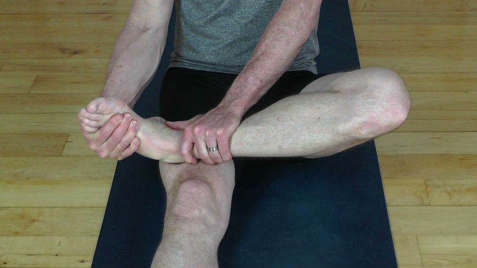 Ankle stretch using one hand as a fulcrum.