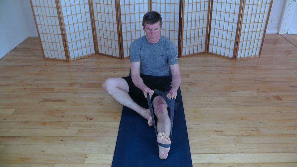 Calf stretch using yoga strap.
