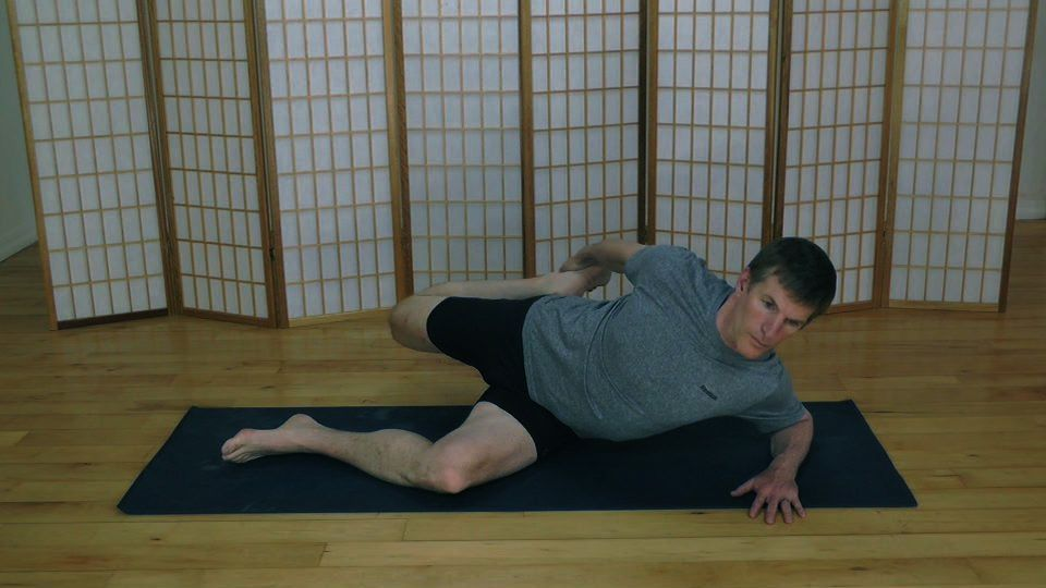 Quad stretch in a side-lying position using Active Isolated Stretching.
