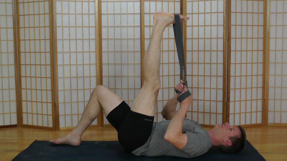 Hamstring stretch using a yoga strap and Active Isolated Stretching.