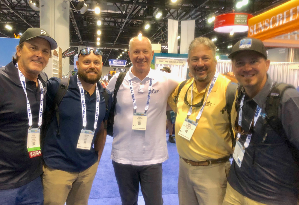 From left: KWF Ambassadors Captain Tony Digulian and photographer Adrian Gray grin along side Neil Horton and Eric Combast of IGFA. Keepemwet founder Bryan Huskey on the end.