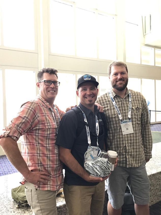 Old friends. Chris Keig and Ryan Thompson of The Fly Fishing Film Tour pose for grip and grin with Bryan Huskey and a Keepemwet fish bowl.