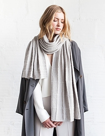 Worked in light and exquisite Sno, this shawl has a graduating grid pattern articulated in simple stockinette lines and seed stitch pattern. This juxtaposition of textures forms gentle pleats when worn loose and long.   Downlown from Ravelry Here