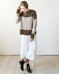 Symmetrically aligned blocks of solid and marled colors help create a canvas of this oversized pullover. Mostly striped and worked with a hint of intarsia to merge the bigger blocks, the pullover is accented with folded hems and matching neckline.   Download from Ravelry Here