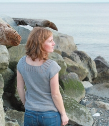 This tee shirt is knit using a cotton linen blend at a loose gauge. The result is an elastic fabric that works up quickly and fits beautifully. The top half of the yoke features a lace panel covering the shoulders and back.     Download from Ravelry Here