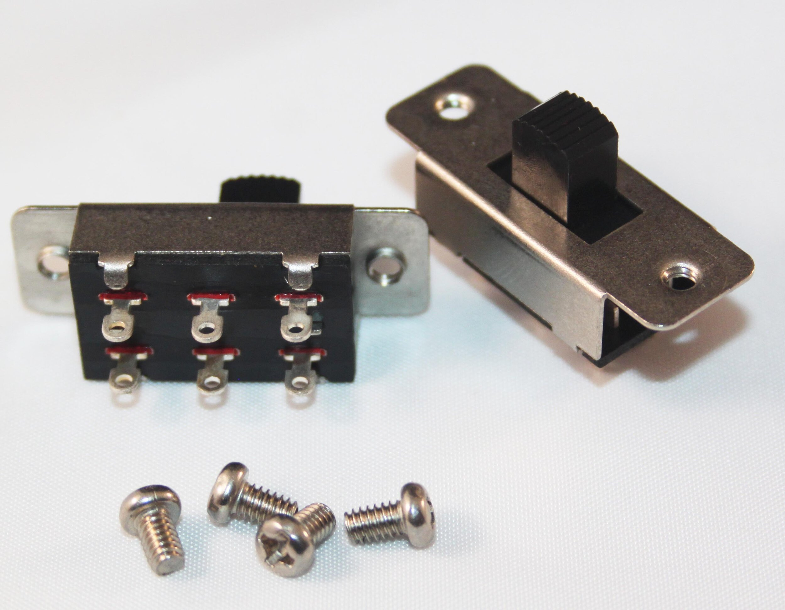"""SLIDE SWITCHES - Small Slide Switches (Pack of 5) - Code: SSWSDPDT. ON-OFF. Supplied with 2 screws per switch.Price: $4.93 (1 - 4 pkts); $4.81 (5 - 9 pkts); $4.64 (10 - 19 pkts); $4.38 (20+)Small Slide Switches with Wires (Pack of 5) - Code: SSWS-WDPDT. ON-OFF. With 100mm Wires. Supplied with 2 screws per switch.Price: $5.19 (1 - 4 pkts); $5.00 (5 - 9 pkts); $4.79 (10 - 19 pkts); $4.70 (20+)Large Slide Switches (Pack of 5) - Code: SSWLDPDT. ON-OFF-ON. With centre """"OFF"""" position. Can be used as a forward/off/reverse switch for solar panels.Supplied with 2 screws per switch.Price: $6.09 (1 - 4 pkts); $6.02 (5 - 9 pkts); $5.72 (10 - 19 pkts); $5.49 (20+)"""