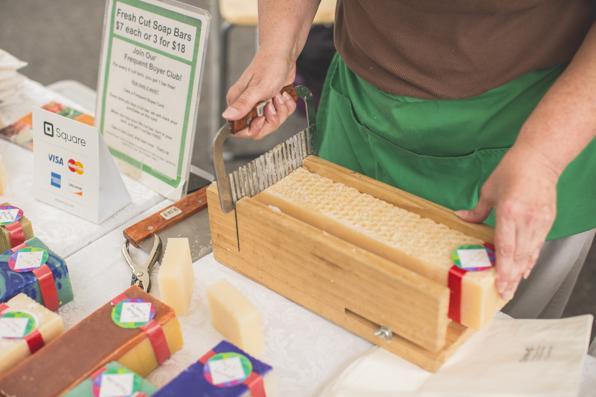 Once the soap is ready for market, it must be sliced into loaves and then cut into bars!