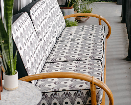 "Revitaliste reupholstered this Vintage Rattan Sofa in Hable Construction ""Rise."""